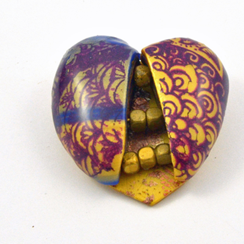 Gold Nuggets in a Heart Pin