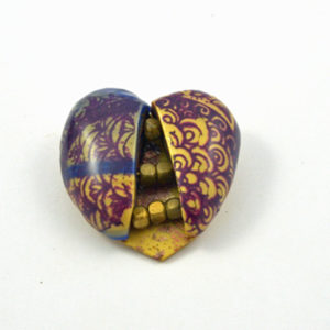 Heart Shaped pin with gold nuggets inside