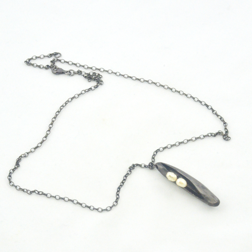 pearl in steel pod pendant necklace